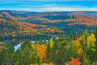 Autumn  colors and Lac Wapizagonke in the Laurentian Mountains from the viewpoint of 'Le Passage'.  Great Lakes - St.  Lawrence Forest Region.<br />La Mauricie National Park<br />Quebec<br />Canada