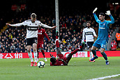 17th March 2019, Craven Cottage, London, England; EPL Premier League football, Fulham versus Liverpool; Sergio Rico of Fulham brings down Sadio Mane of Liverpool for a penalty in the 80th minute