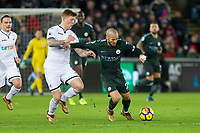Alfie Mawson of Swansea City challenges David Silva of Manchester City during the EPL - Premier League match between Swansea City and Manchester City at the Liberty Stadium, Swansea, Wales on 13 December 2017. Photo by Mark  Hawkins / PRiME Media Images.
