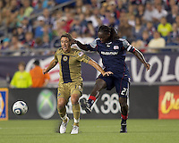 Philadelphia Union midfielder Kyle Nakazawa (13) and New England Revolution midfielder Shalrie Joseph (21) battle at midfield. The Philadelphia Union defeated New England Revolution, 2-1, at Gillette Stadium on August 28, 2010.