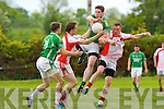 Mike Burke Milltown Castlemaine gets to the ball ahead of Emett Kennedy West Kerry in Milltown on sunday