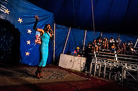 Enrique, a Salvadorean transvestite, performs in front of an audience at the Circo Brasilia, a family run circus travelling in Central America, 10 May 2011. The Circo Brasilia circus belongs to the old-fashioned traveling circuses with a usual mixture of acrobat, clown and comic acts. Due to the general loss of popularity caused by modern forms of entertainment such as movies, TV shows or internet, these small family enterprises balance on the edge of survival. Circuses were pushed away and now they have to set up their shows in more remote villages. The circus art and culture is slowly dying in Latin America.