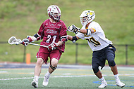 Towson, MD - May 6, 2017: UMASS Minutemen Tyler Bogart (21) is being defended by Towson Tigers Sid Ewell (20) during game between Towson and UMASS at  Minnegan Field at Johnny Unitas Stadium  in Towson, MD. May 6, 2017.  (Photo by Elliott Brown/Media Images International)