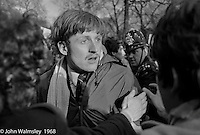 A protestor is annoyed at being moved back by police, anti-Vietnam war demonstration march from Trafalgar Sq to Grosvenor Sq Sunday 17th March 1968.