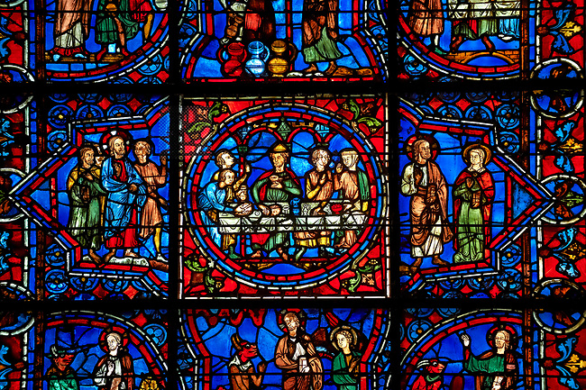 Medieval Windows  of the Gothic Cathedral of Chartres, France, dedicated to Notre Dame de la Belle Verriere. The panels show the wedding at Cana.