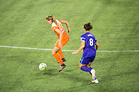 Orlando, Florida - Saturday, April 23, 2016: Houston Dash midfielder Cami Privett (23) controls the ball in front of Orlando Pride forward Sarah Hagen (8) during an NWSL match between Orlando Pride and Houston Dash at the Orlando Citrus Bowl.