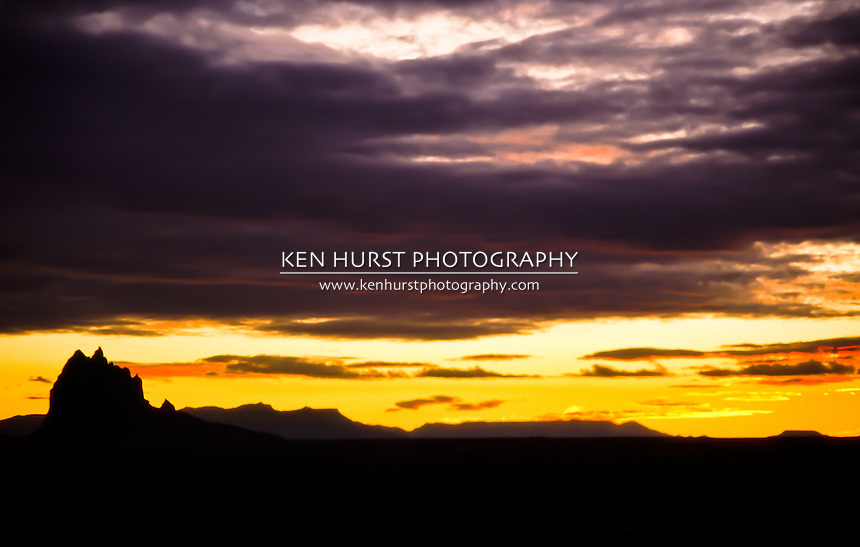 "Shiprock Pinnacle, or ""Tse Bit 'Ai"", near Shiprock, New Mexico at sunset."