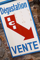 Wine cellar sign in blue. Advertising sale of wine in the wine shop. Collioure. Roussillon. The wine shop and tasting room. France. Europe.