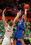 RAPID CITY, S.D. MARCH 20, 2015 -- Robert Shangreaux #54 of Little Wound shoots over Brayden McNeary #23 of Aberdeen Roncalli during their semi-final game at the 2015 South Dakota State A Boys Basketball Tournament at the Don Barnett Arena in Rapid City, S.D.  (Photo by Dick Carlson/Inertia)