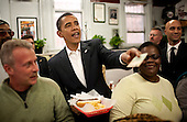 Washington, DC - January 10, 2009 -- United States President-elect Barack Obama pays for a chili half smoke with shredded cheese on the side at Ben's Chili Bowl in Washington, D.C., U.S., Saturday, January 10, 2009.    .Credit: Joshua Roberts - Pool via CNP