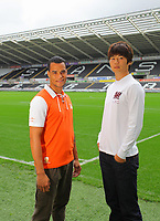 Pictured: Michel Vorm and Ki Sung Yueng<br />