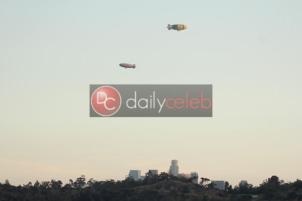 The Goodyear Blimp and the &quot;Despicable Me 2&quot; Blimp<br /> flying over Los Angeles and Dodger Stadium, Los Angeles, CA 06-24-13<br /> David Edwards/Dailyceleb.com 818-249-4998