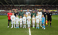 SWANSEA, WALES - FEBRUARY 21: Children mascots with team captains Ashley Williams of Swansea, Wayne Rooney of Manchester and match officials prior to the Barclays Premier League match between Swansea City and Manchester United at Liberty Stadium on February 21, 2015 in Swansea, Wales.