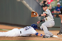 Salt Lake Bees first baseman Luis Rodriguez (6) catches a pick off throw as Round Rock Express base runner Jim Adduci (24) dives back to the bag during the Pacific Coast League baseball game on August 10, 2013 at the Dell Diamond in Round Rock, Texas. Round Rock defeated Salt Lake 9-6. (Andrew Woolley/Four Seam Images)