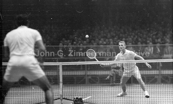 Australian tennis player Lew Hoad in action against Pancho Gonzales, Madison Square Garden, 2/1958. Photography by John G. Zimmerman.