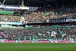 """02.11.2019, wohninvest WESERSTADION, Bremen, GER, 1.FBL, Werder Bremen vs SC Freiburg<br /> <br /> DFL REGULATIONS PROHIBIT ANY USE OF PHOTOGRAPHS AS IMAGE SEQUENCES AND/OR QUASI-VIDEO.<br /> <br /> im Bild / picture shows<br /> Startelf SV Werder Bremen vor den Fans der Ostkurve, <br /> Banner in Block 2 vor wohninvest Loge verdeckt die Sicht auf Spielfeld, <br /> Schriftzug """"Immobilienhaie - Vorsicht bissig!"""", <br /> <br /> Foto © nordphoto / Ewert"""