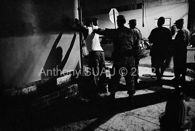 New Orleans, Louisiana.USA.July 29, 2006..The National Guard patrols New Orleans after a wave of killings as people move back to the city following hurricane Katrina nearly one year ago. A suspected drug bust turns up no drugs in the cities 5th district...