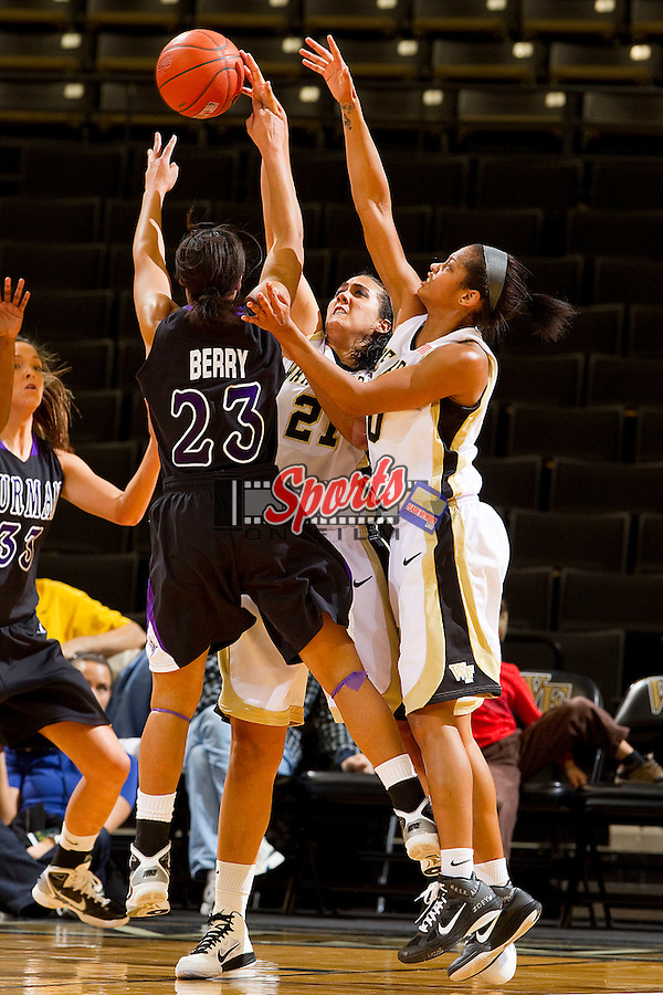 Sandra Garcia #21 and Brittany Waters #20 of the Wake Forest Demon Deacons battle for the ball with Kendra Berry #23 of the Furman Paladins at the Lawrence Joel Coliseum on December 22, 2010 in Winston-Salem, North Carolina.  The Demon Deacons defeated the Paladins 84-35.  Photo by Brian Westerholt / Sports On Film