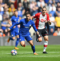 Southampton's Oriol Romeu (right)  vies for possession with Chelsea's Eden Hazard (left) <br /> <br /> Photographer David Horton/CameraSport<br /> <br /> The Premier League - Southampton v Chelsea - Saturday 14th April2018 - St Mary's Stadium - Southampton<br /> <br /> World Copyright &copy; 2018 CameraSport. All rights reserved. 43 Linden Ave. Countesthorpe. Leicester. England. LE8 5PG - Tel: +44 (0) 116 277 4147 - admin@camerasport.com - www.camerasport.com
