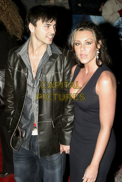 "ANDY SCOTT-LEE & MICHELLE HEATON.Premiere of ""Polar Express"", Vue cinema, Leicester Square, London, November 17th 2004..half length couple black dress.Ref: AH.www.capitalpictures.com.sales@capitalpictures.com.©Capital Pictures."