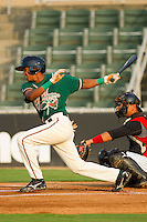 Jose Duarte #15 of the Greensboro Grasshoppers follows through on his swing against the Kannapolis Intimidators at Fieldcrest Cannon Stadium August 2, 2010, in Kannapolis, North Carolina.  Photo by Brian Westerholt / Four Seam Images