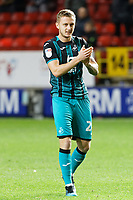 Ben Wilmot of Swansea City thanks away supporters during the Sky Bet Championship match between Charlton Athletic and Swansea City at The Valley, London, England, UK. Wednesday 02 October 2019