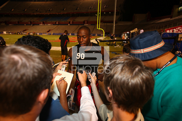 20 October 2007: Stanford Cardinal Udeme Udofia and the media during Stanford's 21-20 win against the Arizona Wildcats at Arizona Stadium in Tucson, AZ.