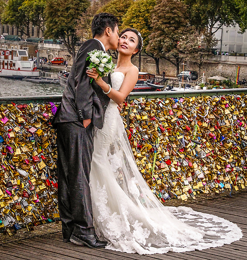 "Paris: A wedding kiss on the ""Bridge of Locks."""