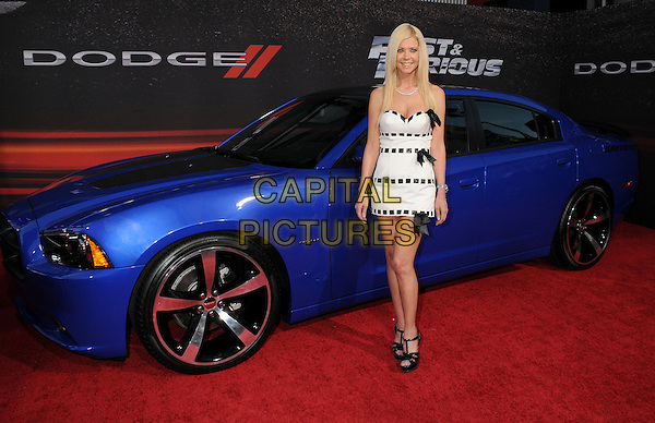 """Tara Reid.""""Fast & Furious 6"""" Los Angeles Premiere held at the Universal Gibson Amphitheatre, Universal City, California, USA..May 21st, 2013.full length dress ribbons bows sandals shoes white black weave strapless  car  .CAP/ADM/BP.©Byron Purvis/AdMedia/Capital Pictures"""