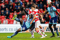 Adebayo Akinfenwa of Wycombe Wanderers (left) during the Sky Bet League 2 match between Doncaster Rovers and Wycombe Wanderers at the Keepmoat Stadium, Doncaster, England on 29 October 2016. Photo by David Horn.