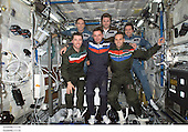 The Expedition Four and Soyuz 4 Taxi crews pose for a group photo in the Destiny laboratory on the International Space Station (ISS). The Soyuz 4 Taxi crew (front row), from the left, are flight engineer Roberto Vittori, commander Yuri Gidzenko, and South African space flight participant Mark Shuttleworth. The Expedition Four crew (back row), from the left, are astronaut Carl E. Walz, flight engineer; cosmonaut Yury I. Onufrienko, mission commander; and astronaut Daniel W. Bursch, flight engineer. Onufrienko and Gidzenko represent Rosaviakosmos and Vittori represents the European Space Agency (ESA). <br /> Credit: NASA via CNP