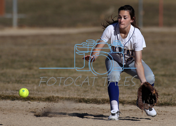 Madison Gonzales fields an infield hit for Western Nevada College during a college softball game against Salt Lake Community College on Friday, Feb. 15, 2013, in Carson City, Nev. SLCC won the opener 4-2..Photo by Cathleen Allison