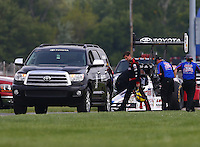Sept. 1, 2014; Clermont, IN, USA; The Toyota tow vehicle gets ready to tow NHRA top fuel dragster driver Morgan Lucas back to the pits during the US Nationals at Lucas Oil Raceway. Mandatory Credit: Mark J. Rebilas-USA TODAY Sports