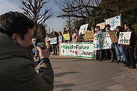 "A photographer for the media shoots a group of mostly young Japanese people take part in a demonstration as part of the ""Fridays for Future"" movement outside the National Diet Building in Tokyo, Japan. Friday February 22nd 2019. Around 30 people took part in the demonstration in which started at 3pm. The Glbal Strike for Future was started by Swedish school student, Greta Thunberg who began striking from her school to demand adults do something about climate change to ensure the furture she was studying for. Since then thousands of strikes have taken place around the world. This was the first such strike in Japan and though no school students left their schools to take part the organisers hope the Global Strike for Future on March 15th will attract many young people in Japan"