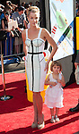 Ashley Scott and daughter arriving at the World Premiere of Planes held at El Capitan Theatre in Los Angeles, Ca. August 5, 2013.