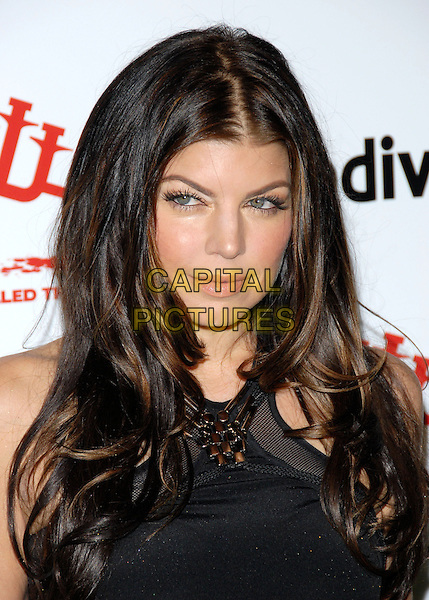 FERGIE (STACY FERGUSON) of the Black Eyed Peas .at The First Annual Data Awards held at The Hollywood Palladium in Hollywood, California, USA, January 29th 2010.                                                                   .arrivals portrait headshot black embellished .CAP/RKE/DVS.©DVS/RockinExposures/Capital Pictures.