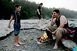 From left, Cory Hall, 8, Patricia Johnson, 17, and Javan Saffell enjoy a barbecue along the Eel River in Scotia, CA on Tuesday, June 27, 2006. The Halls are the fourth generation of their family to grow up in Scotia. The town of Scotia in Northern California is a company town owned by the Pacific Lumber Company (PALCO), but that will change as the company will begin to sell the town. (Photo by Max Whittaker for The New York Times)<br />