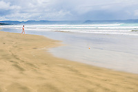 Tourist on 90 Mile Beach, Northland, New Zealand