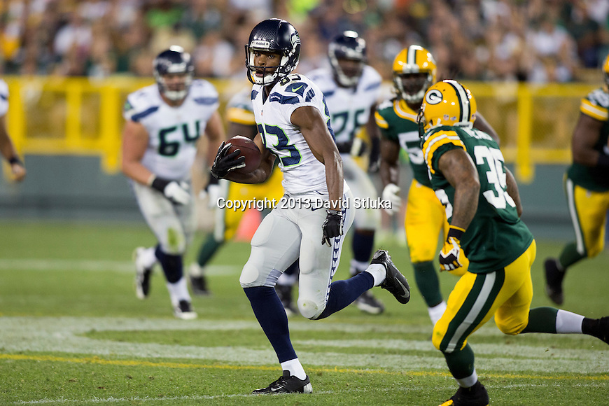 Seattle Seahawks wide receiver Stephen Williams (83) carries the ball after a reception during an NFL preseason week 3 football game against the Green Bay Packers Thursday, August 23, 2013, in Green Bay, Wis. The Seahawks won 17-10 . (Photo by David Stluka)