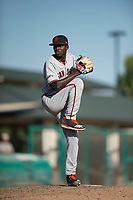 San Jose Giants relief pitcher Sandro Cabrera (18) prepares to deliver a pitch during a California League game against the Modesto Nuts at John Thurman Field on May 9, 2018 in Modesto, California. San Jose defeated Modesto 9-5. (Zachary Lucy/Four Seam Images)