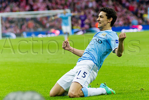 02.03.2014 London, England. Manchester City's Jesus NAVAS celebrates scoring his side's third goal to make it 3-1 during the Capital One Cup Final between Manchester City and Sunderland at Wembley Stadium