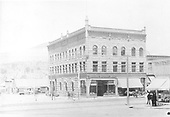 Smelter National Bank - Three story stone Newman Block on Main Ave..  Horse-drawn vehicles.  Street car tracks.  Loading box car from wagon in background.<br /> D&amp;RG  Durango, CO  ca 1910