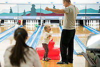 NWA Democrat-Gazette/CHARLIE KAIJO Josh Bishop of Bentonville (right) cheers with his daughter Molly Bishop, 3, while bowling, Sunday, February 11, 2018 at the Rogers Bowling Center in Rogers. Low temperatures left many of the roads icey. <br /><br />&quot;My wife is pregnant, and we&acirc;&euro;&trade;re trying to induce labor via bowling,&quot; said Josh Bishop, the girl's father.