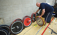 27 MAY 2013 - DONCASTER, GBR - Kent Crusaders mechanic John Davies sorts the teams wheels before the 2013 Great Britain Wheelchair Rugby Nationals final between the Crusaders and the Stoke Mandeville Storm at The Dome in Doncaster, South Yorkshire .(PHOTO (C) 2013 NIGEL FARROW)