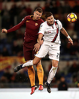 Calcio, Serie A: Roma vs Cagliari, Roma, stadio Olimpico, 22 gennaio 2017.<br /> Roma's Edin Dzeko, left, and Cagliari's Luca Ceppitelli, right, jump for the ball during the Italian Serie A football match between Roma and Cagliari at Rome's Olympic stadium, 22 January 2017. <br /> UPDATE IMAGES PRESS/Isabella Bonotto
