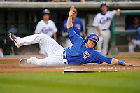 Mike Olt #33 of the Iowa Cubs scores a run against the New Orleans Zephyrs at Principal Park on July  24, 2014 in Des Moines, Iowa. The Cubs won 11-2.   (Dennis Hubbard/Four Seam Images)