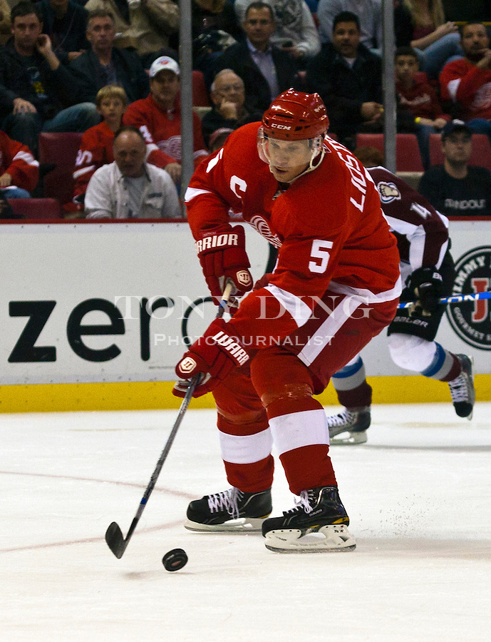12 October 2010: Detroit Red Wings defenseman Nicklas Lidstrom (5) handles the puck in the second period of the Colorado Avalanche at Detroit Red Wings NHL hockey game, at Joe Louis Arena, in Detroit, MI...***** Editorial Use Only *****