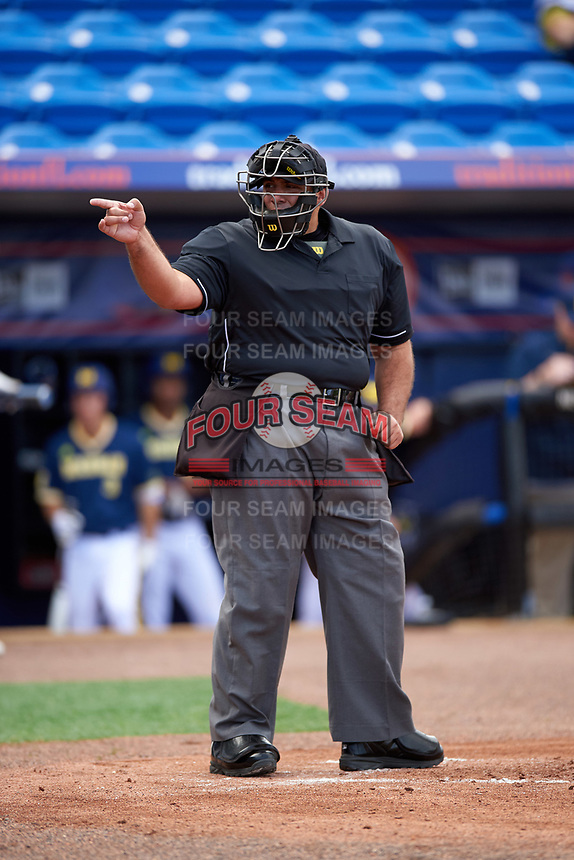 Umpire Kyle Reese during the second game of a doubleheader against the Michigan Wolverines and Canisius College Golden Griffins on February 20, 2016 at Tradition Field in St. Lucie, Florida.  Michigan defeated Canisius 3-0.  (Mike Janes/Four Seam Images)