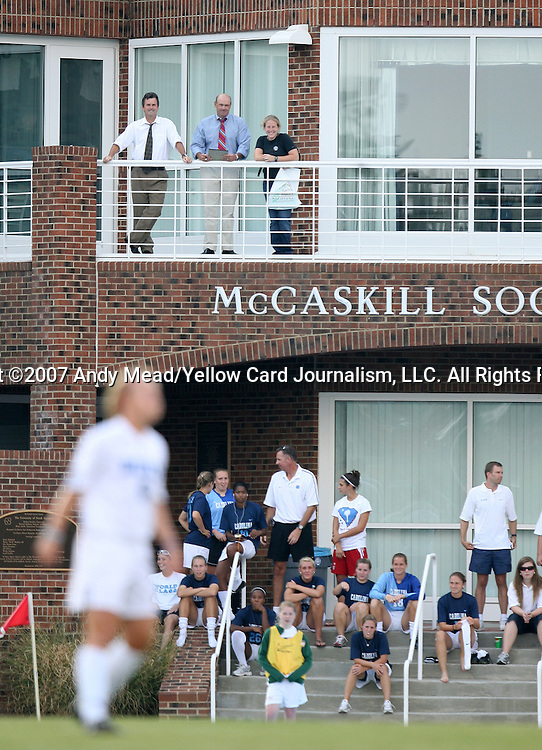 07 September 2007: University of North Carolina head coach Anson Dorrance (above left), assistant coach Bill Palladino (above center), and players (below, on steps) watch the game. The Duke University Blue Devils defeated the Yale University Bulldogs 1-0 at Fetzer Field in Chapel Hill, North Carolina in an NCAA Division I Women's Soccer game, and part of the annual Nike Carolina Classic tournament.
