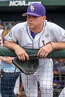 LSU Tigers pitcher Austin Bain (18) in the dugout before the NCAA College World Series game against the TCU Horned Frogs in the on June 14, 2015 at TD Ameritrade Park in Omaha, Nebraska. TCU defeated LSU 10-3. (Andrew Woolley/Four Seam Images)